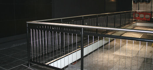 BMW Mini, Pre Showroom Opening. Black coated stainless steel balustrade with top rail and vertical tension wires